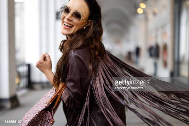 German singer Jasmin Wagner wearing a dark brown leather jacket with fringe detail by Zara, cream colored wide leg pants by Guido Maria Kretschmer, a...