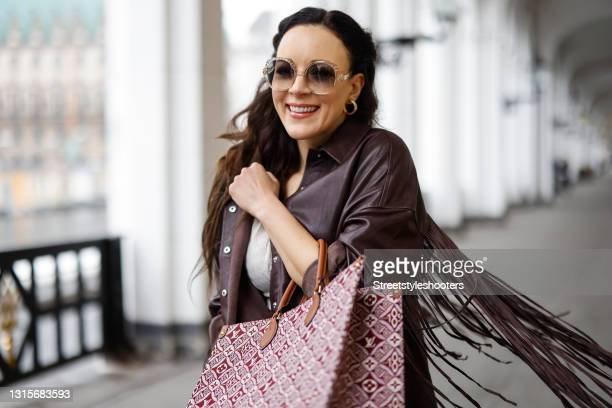 German singer Jasmin Wagner wearing a dark brown leather jacket with fringe detail by Zara, a cream colored bandeau top by Guido Maria Kretschmer, a...