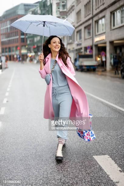 German singer Jasmin Wagner wearing a pastel pink coat by Harris Wharf London, a light blue shirt by Nili Lotan, light blue sweatpants by Nili Lotan,...
