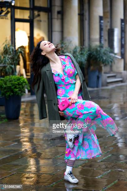 German singer Jasmin Wagner wearing a turquoise and pink floral maxi dress by Rixo, a dark olive green blazer by Guido Maria Kretschmer, a pink...