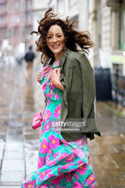 German singer Jasmin Wagner wearing a turquoise and pink floral maxi dress by Rixo, a dark olive green blazer by Guido Maria Kretschmer and a pink...