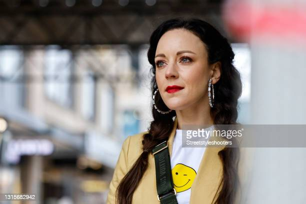 German singer Jasmin Wagner wearing a white shirt with a yellow smiley face by Kule and a yellow blazer by Veronica Beard during a street style...