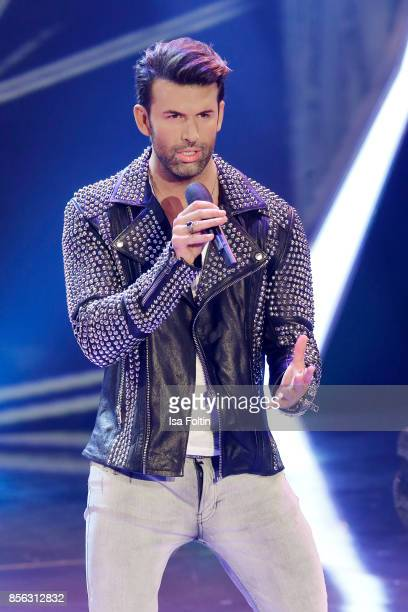German singer Jay Khan performs during the tv show 'Willkommen bei Carmen Nebel' at TUI Arena on September 30 2017 in Hanover Germany