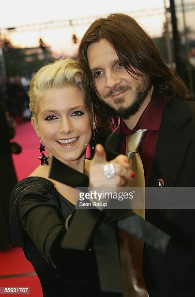 German singer Jeanette Biedermann and her boyfriend Joerg Weissenberg arrive at the German Television Awards at the Coloneum on October 15 2005 in...