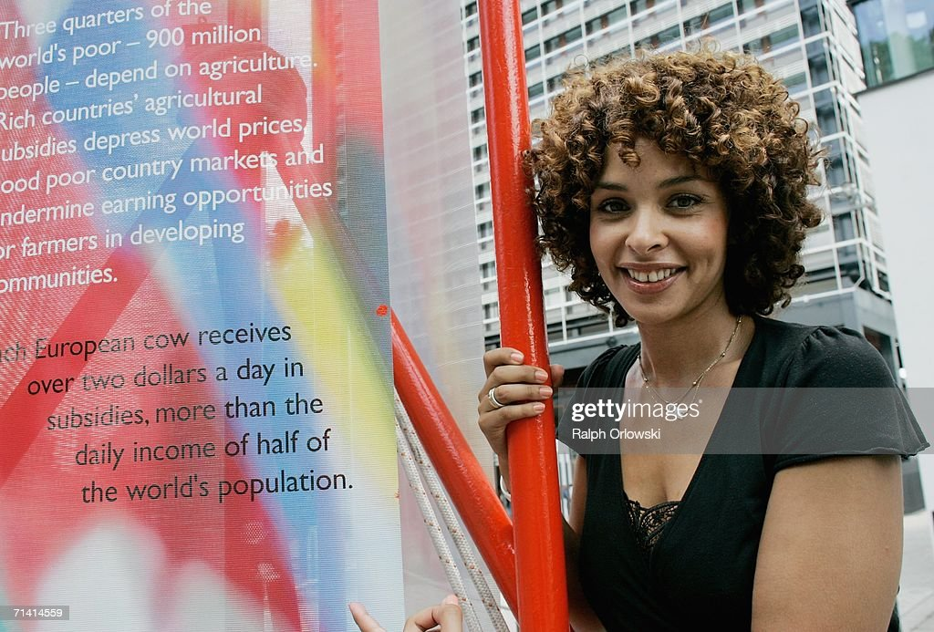 German singer Joy Delanane, ambassadress for the United nations 'UN-Milenium-Campaign', poses next to a poster in front of the German United Nations headquarters on July 11, 2006 in Bonn, Germany. U.N. General-secretary Kofi Annan and German Chancellor Angela Merkel inaugurated the United Nations campus, the German U.N. headquarters, in the former West German capital of Bonn.