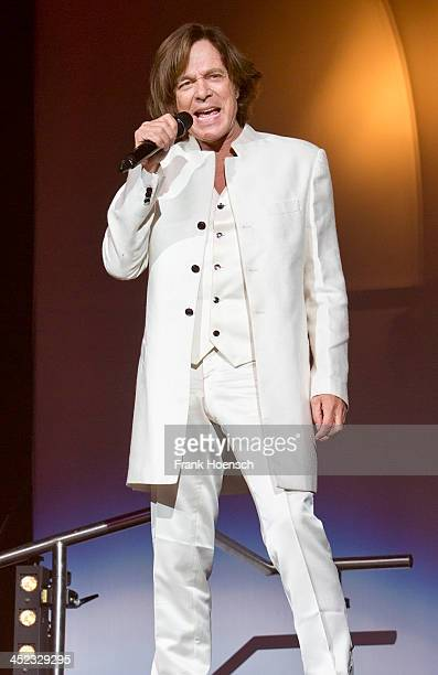 German singer Juergen Drews performs live during the 'Schlagernacht des Jahres' at the O2 World on November 23 2013 in Berlin Germany