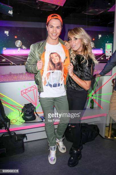 German singer Julian David and German singer Annemarie Eilfeld during the 'VIP 90's Let's Glow' Opening Party at Madame Tussauds on March 27 2018 in...