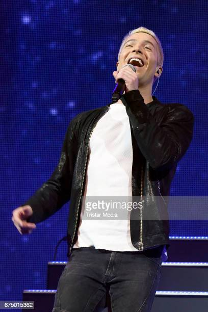 German singer Julian David performs during 'Die Schlagernacht des Jahres' at Lanxess Arena on April 29 2017 in Cologne Germany