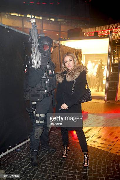 German singer Kim Gloss Social with a Resident Evil figure during the Social Movie Night At 'Resident Evil The Final Chapter' premiere at CineStar on...