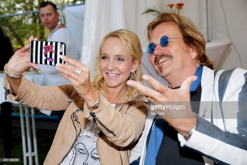 German singer Kristina Bach and German singer Frank Zander doing a selfie during the SchlagerOlymp Open Air Festival at Freizeit und Erholungspark Luebars on August 12, 2017 in Berlin, Germany.