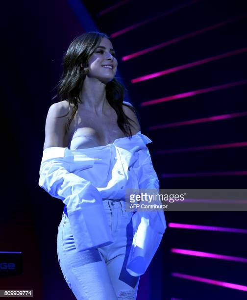 German singer Lena MeyerLandrut loses her blouse during the Global Citizen Festival G20 benefit concert in Hamburg northern Germany on July 6 2017 on...