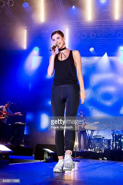 German singer Lena MeyerLandrut performs live during a concert at the NDR Sommertour on June 24 2016 in Klink near Waren Germany