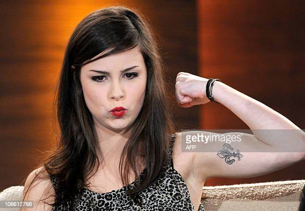 German singer Lena MeyerLandrut shows her tattoo during the TV show Wetten dass in the northern German city of Hanover on November 6 2010 AFP PHOTO...