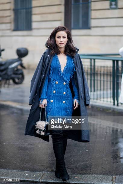 German singer Lena MeyerLandrut wearing Balmain dress Balenciaga coat over knees boots bag on March 2 2018 in Paris France