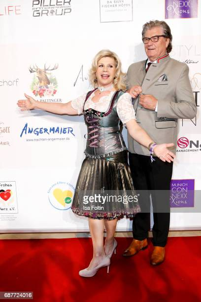 German singer Marianne Hartl and her husband Michael Hartl attend the Kempinski Fashion Dinner on May 23 2017 in Munich Germany