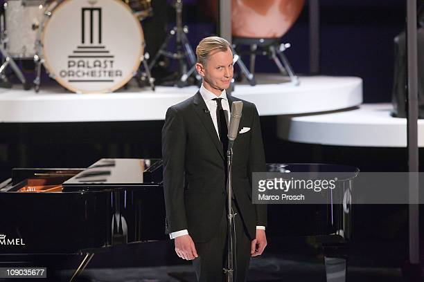 German singer Max Raabe performs during the 193th 'Wetten Dass' show at the Messe Halle on February 12 2011 in Halle Germany