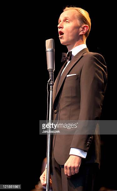 German singer Max Raabe performs live with his Palast Orchester during a concert at the Waldbuehne on August 20 2011 in Berlin Germany