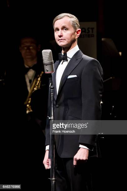 German singer Max Raabe performs live with Palastorchester during a concert at the Admiralspalast on February 28 2017 in Berlin Germany