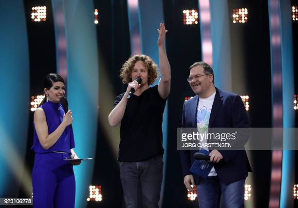 German singer Michael Schulte speaks next to TV hosts Linda Zervakis and Elton after he was selected to represent Germany for the Eurovision Song...