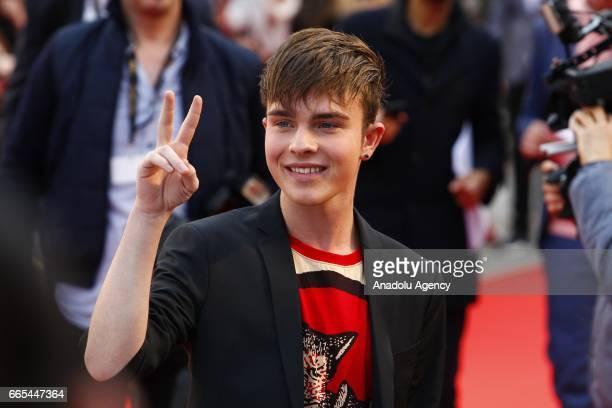 German singer Mike Singer gestures during the Red Carpet of the ECHO German Music Award in Berlin Germany on April 06 2017