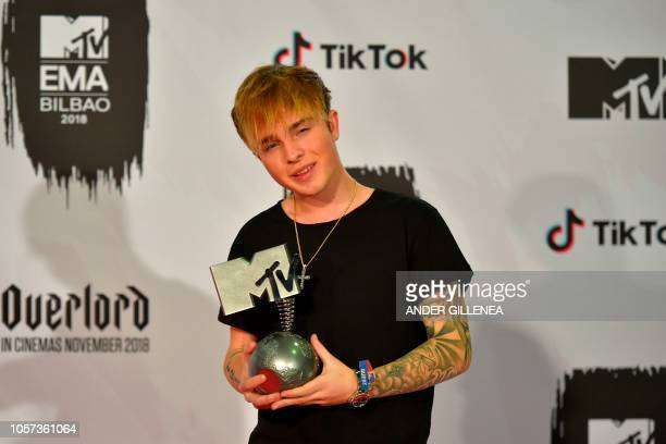 German singer Mike Singer poses backstage with his Best German Act award during the MTV Europe Music Awards at the Bizkaia Arena in the northern...
