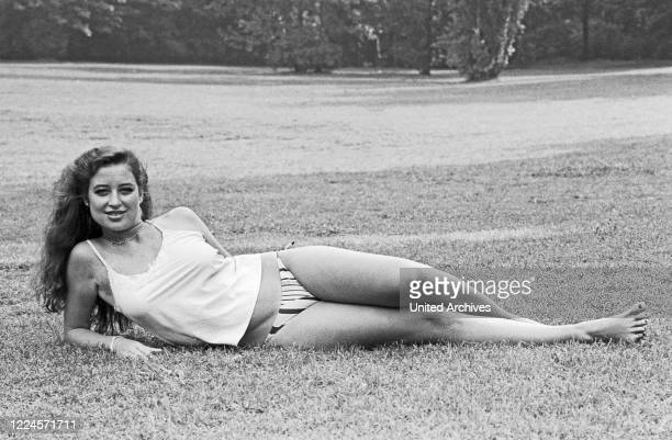 German singer musical actress and TV host Isabel Varell posing for a photo shooting at a public garden Germany circa 1984
