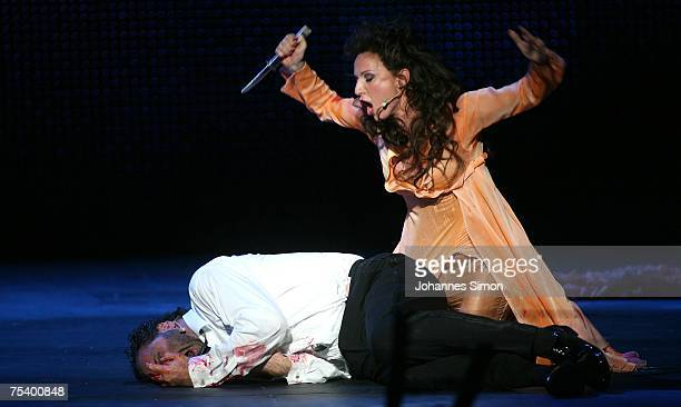 """German singer Nadja Michael as """"Tosca"""" and Israeli singer Gison Saks as """"Baron Scarpia"""" perform on the floating stage during the rehearsal of the..."""