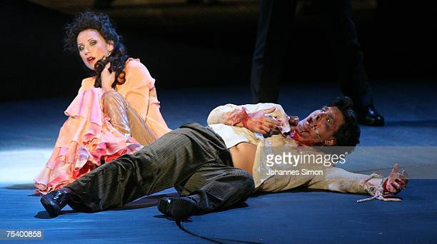 """German singer Nadja Michael as """"Tosca"""" and Serbian Zoran Todorovich as """"Mario Cavaradossi"""" perform on the floating stage during the rehearsal of the..."""