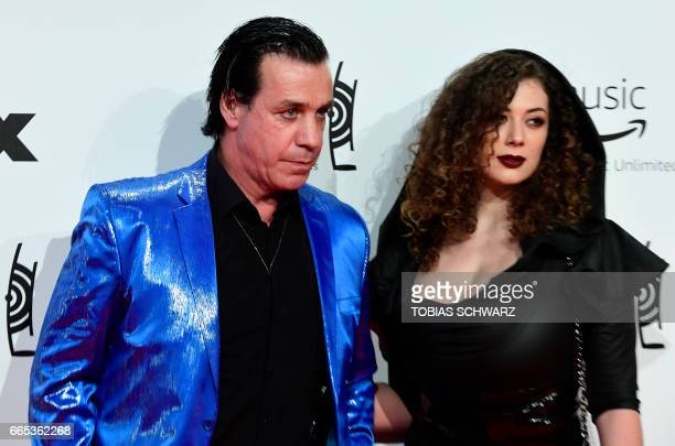 German singer of group Rammstein Till Lindemann and friend Leila Lowfire arrive for the 2017 Echo Music Awards in Berlin on April 6 2017 / AFP PHOTO...