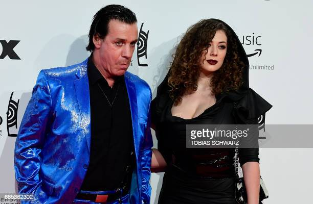 German singer of group Rammstein, Till Lindemann, and friend Leila Lowfire arrive for the 2017 Echo Music Awards in Berlin, on April 6, 2017. / AFP...