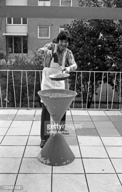German singer Oliver Freytag having a barbecue, Germany, 1960s.