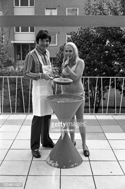German singer Oliver Freytag having a barbecue with girl friend Lisa, Germany, 1960s.