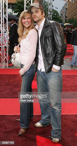 German singer Patrick Nuo and his girlfriend actress Molly Schade arrive for the German premiere of War of the Worlds at the Theater am Potsdamer...