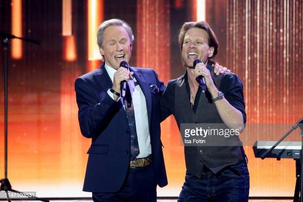 German singer Peter Kraus and his son Mike Kraus perform during the television show 'Willkommen bei Carmen Nebel' at Velodrom on May 4, 2019 in...
