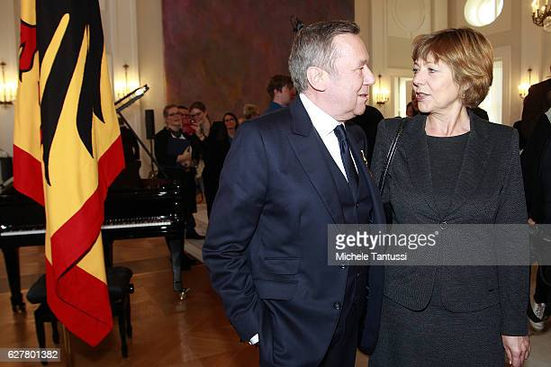 German singer Roland Kaiser chat with President's partner Daniela Schadt during the Federal Cross of Merit award ceremony in Bellevue Castle on...
