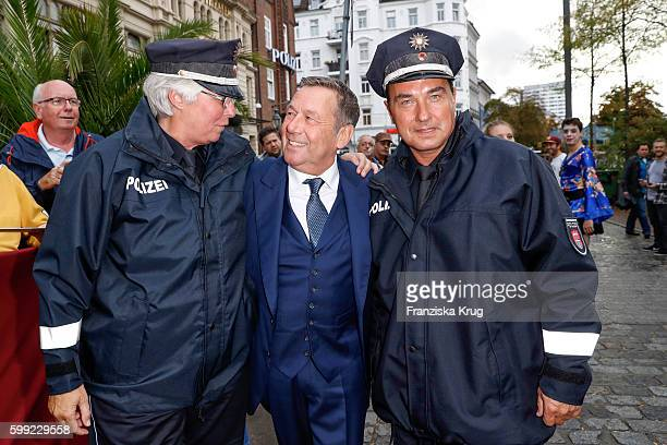 German singer Roland Kaiser with two police man attend the 'Nacht der Legenden' at Schmidts Tivoli on September 04 2016 in Hamburg Germany