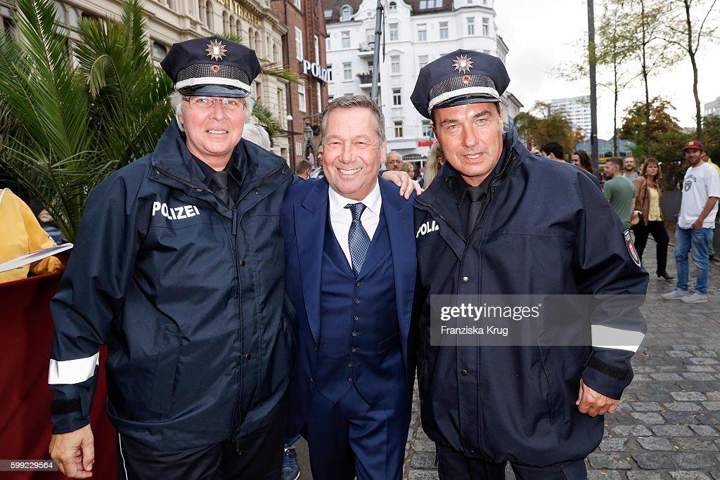 German singer Roland Kaiser with two police man attend the 'Nacht der Legenden' at Schmidts Tivoli on September 04, 2016 in Hamburg, Germany.