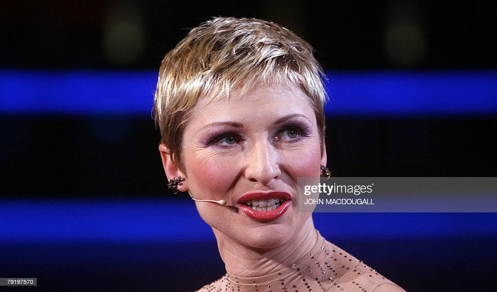 German singer Sabine Hettlich speaks to reporters during a press preview of the Friedrichstadtpalast music hall's latest show 'Glanzlichter der Revue' (Limelights of the Revue) in Berlin 24 January 2008. The show leading from the 1920s cabaret passing over Broadway shows to Parisian revue opens 25 January 2008 and runs until 29 June 2008.