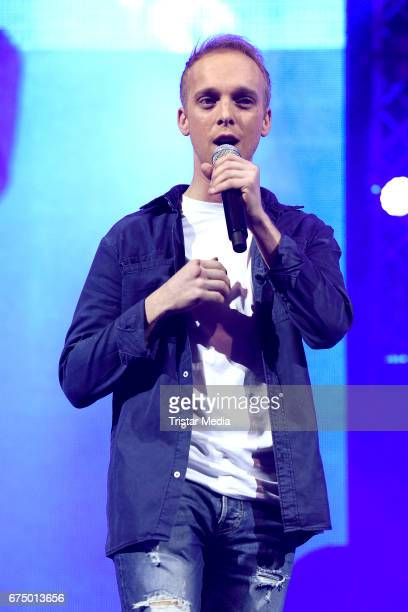 German singer Sandro Malinowski performs during 'Die Schlagernacht des Jahres' at Lanxess Arena on April 29 2017 in Cologne Germany