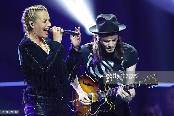 German singer Sarah Connor and British musician James Bay perform during the 2016 Echo Music Awards in Berlin, on April 7, 2016. / AFP / POOL /...