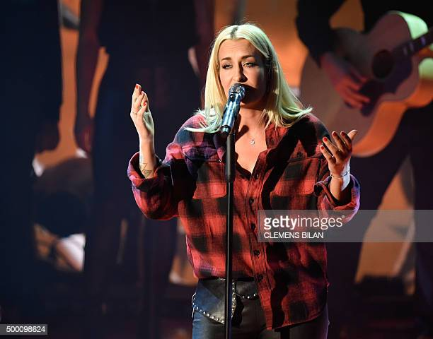 German singer Sarah Connor performs at the ZDF live broadcast 'Ein Herz fuer Kinder' at Tempelhof Airport in Berlin AFP PHOTO / POOL / CLEMENS BILAN...