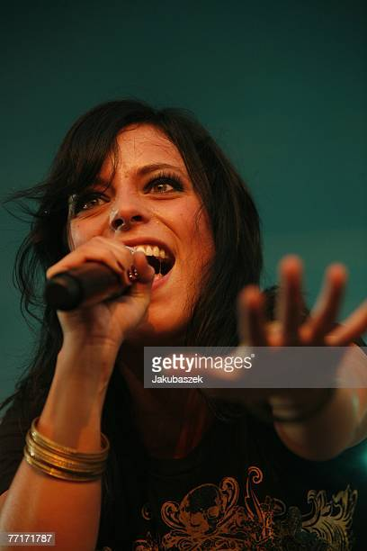 German singer Stefanie Kloss of the band Silbermond performs live during a concert at the Brandenburg Gate October 3 2007 in Berlin Germany The...
