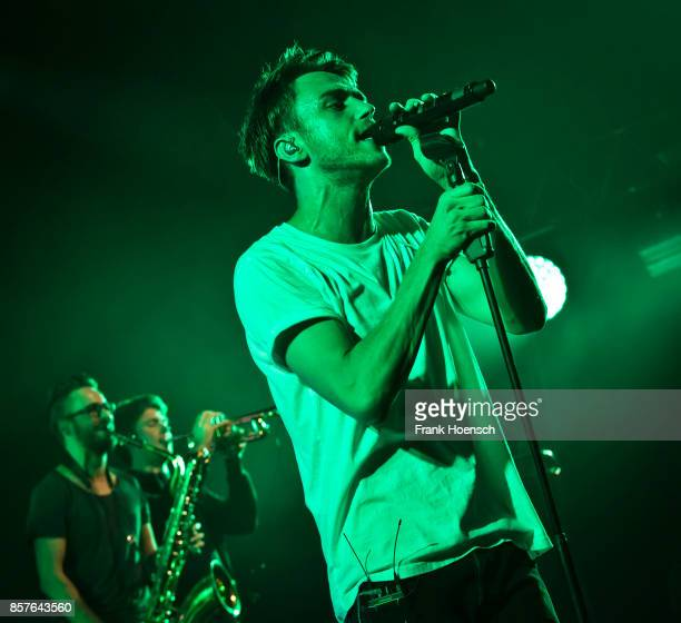 German singer Thomas Huebner aka Clueso performs live on stage during a concert at the Tempodrom on October 4 2017 in Berlin Germany