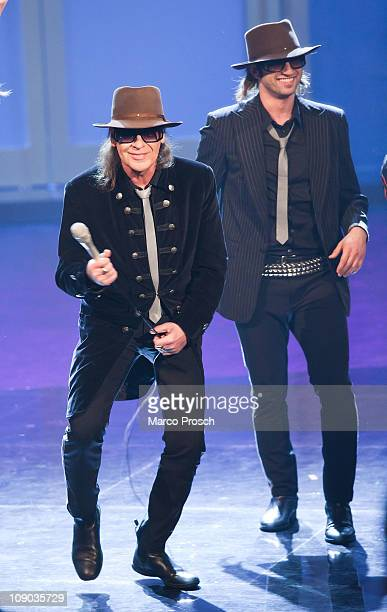 German singer Udo Lindenberg and the cast of musical Hinterm Horizont perform during the 193th 'Wetten Dass' show at the Messe Halle on February 12...