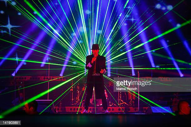 German singer Udo Lindenberg performs on stage at the Arena on March 25 2012 in Leipzig Germany