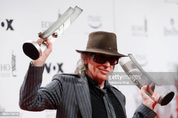 German singer Udo Lindenberg poses with his awards during the Echo award winners board on April 6 2017 in Berlin Germany
