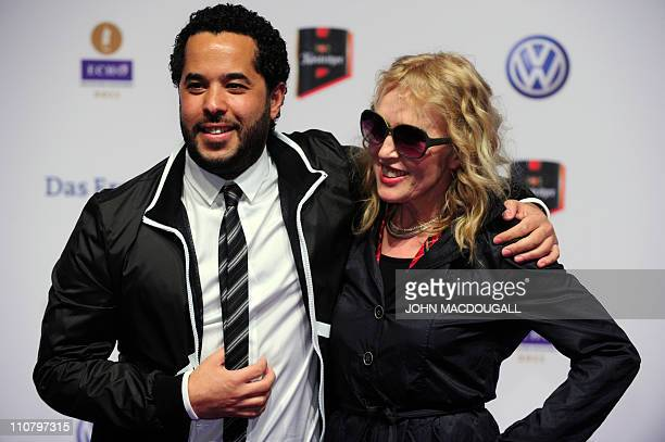 German singers Adel Tawil and Annette Humpe from the band 'Ich Ich' pose for photographers as they arrive on the red carpet for the 'Echo' music...