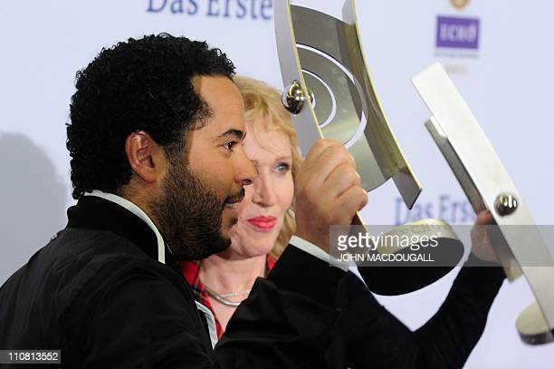 German singers Adel Tawil and Annette Humpe from the band 'Ich Ich' pose with their Echo received in the category 'Best National Rock/Pop group' at...