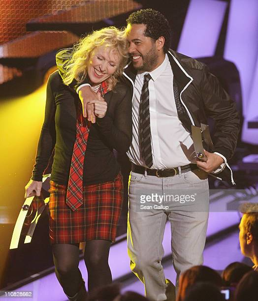 German singers Annette Humpe and Adel Tawil of the band Ich Ich walk offstage after receiving their Best Band National Award at the Echo Awards 2011...