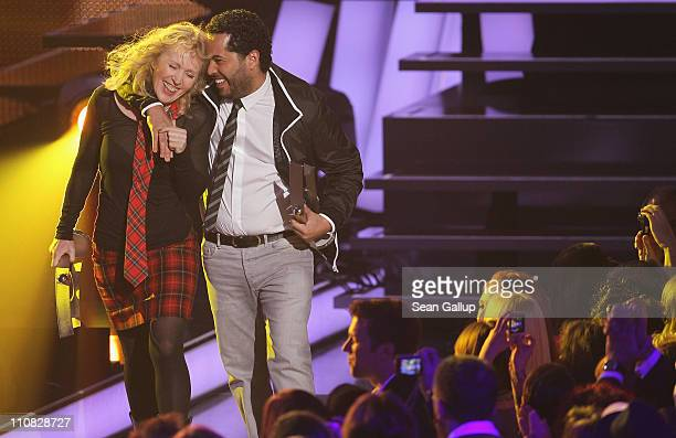 German singers Annette Humpe and Adel Tawil of the band 'Ich Ich' walk offstage after receiving their Best Band National Award at the Echo Awards...